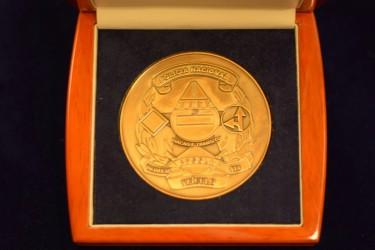 Ukázka medaile pro zákazníka z Angoly