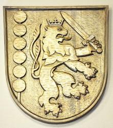 Vyřezávaný znak obce Držkov