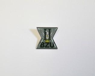 Zakázková výroba odznaků s logem firmy.
