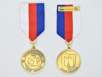 Zakázková výroba oboustranných medailí.