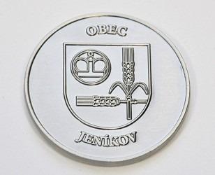 Pamětní mince se znakem a názvem obce Jeníkov.