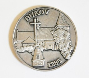 Výroba pamětních oboustranných mincí na zakázku.