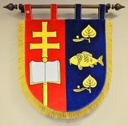 Znak vyšívaný kovovými nitěmi pro obec Rácovice