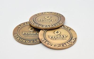Zakázková výroba pamětních medailí/mincí.