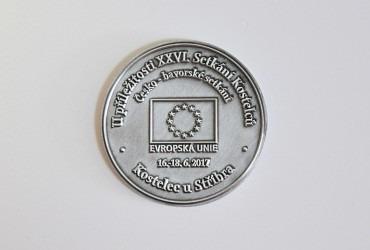 Pamětní oboustranná mince s vlastní grafikou.