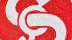 Výšivka tradičně vyobrazovaného nápisu SOKOL.